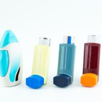 Selection of 4 asthma puffers lined up in a row