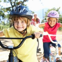 Children out for a bike ride with their parents getting exercise